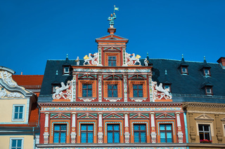Top part of ornate historical timbered house facade in Erfurt