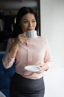 Portrait of businesswoman having coffee
