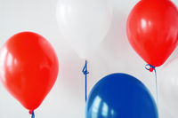 party decoration with red, white and blue balloons