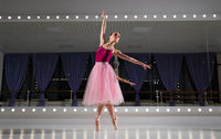 Young ballerina in training hall