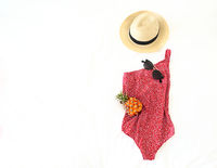 Summer vacation concept with swimwear sunglasses hat and pineapple