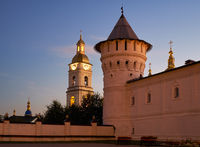 Corner tower of the Seating courtyard and belfry of the Tobolsk Kremlin at sunset. Tobolsk. Russia