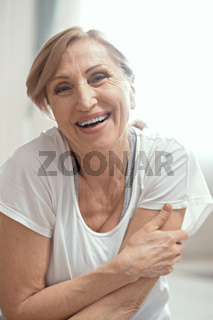 Beautiful woman smiles and does yoga exercise.
