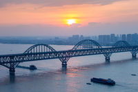 jiujiang yangtze river bridge closeup in sunset