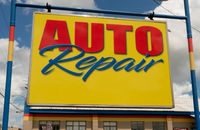 Bright Yellow and Blue Sign Advertising an Auto Repair Shop