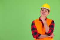 Happy young multi ethnic man construction worker thinking