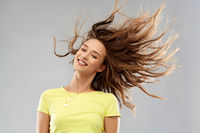 happy young woman with waving long hair