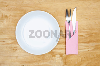 White plate on the wooden table.