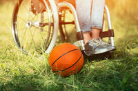 Basket ball is laying near wheelchair