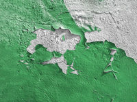Green wall with the peeled-off paint