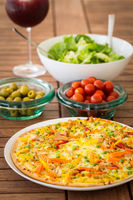 Thai pizza with vegetables and salad