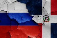 flags of Russia and Dominican Republic painted on cracked wall