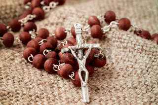 Rosary on old fabric background