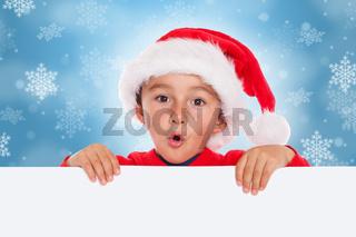 Kind Weihnachtsmann Nikolaus Weihnachten Weihnachtskarte Karte Textfreiraum Copyspace überrascht erstaunt Überraschung