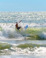Unrecognizable surfer surf a wave