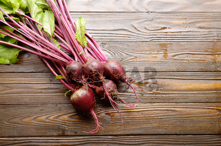 Top view at Fresh organic beetroots on kitchen wooden rustic table