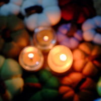 colorful background with candles, pumpkin