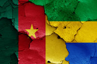 flags of Cameroon and Gabon painted on cracked wall