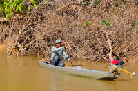 CORUMBA, MATO GROSSO, BRAZIL, JULY 23, 2018: Traditional indigenous fisherman in boat on Rio Paraguay river, Pantanal