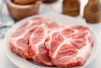 Raw fresh pork neck meat steaks