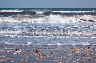 The surf at the Jurassic coast beach.  Lyme Regis. West Dorset, England.