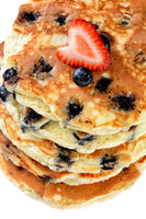 Closeup of a stack of fresh homemade blueberry pancakes Topped with a Strawberry