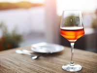 Glass of rose wine on table outdoor
