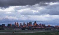 A storm brews over Kansas City downtown and the municipal airport