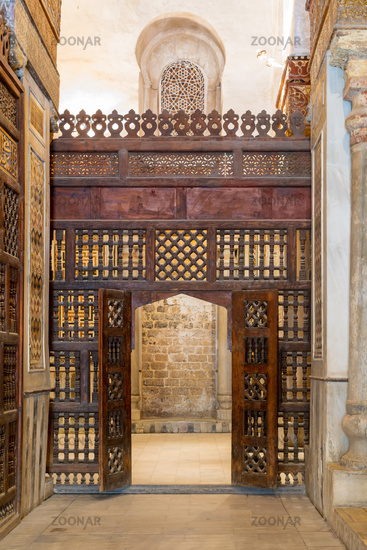 Interleaved wooden wall, known as mashrabiya, with wooden ornate door