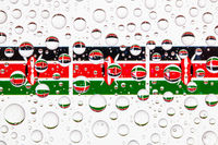 Water drops on glass and Kenya flags.