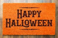 Happy Halloween Orange Welcome Mat On Wood Floor Background