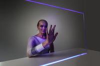 Woman touching virtual display