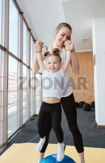 little girl and mom having fun