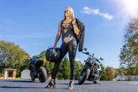 Beautiful Blonde Model Posing With A Street Motorcycle On A Sunny Day
