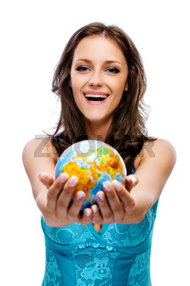smiling beautiful woman with dark hair in blue dress with globe