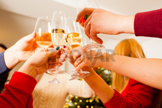 Angle view of hands of people toasting and cheering