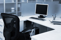 computer behind the glass in modern office
