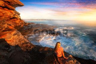 Watching the ocean cascade around coastal rocks