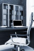 laptop on a desk in office