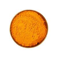 One bronze metal bowl full of yellow turmeric powder