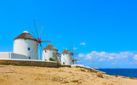 Famous old windmillls on the seashore in Mykonos Island