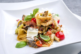 Traditional Italian pappardelle alla cozze with mushrooms and parmesan as close-up on a plate