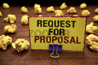 Handwriting text writing Request For Proposal. Concept meaning document contains bidding process by agency or company Yellow sticky card clipped text notice crumpled paper balls wood table.