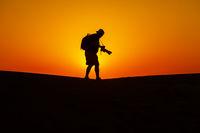 Desert and man at sunset