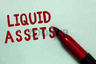 Handwriting text Liquid Assets. Concept meaning Cash and Bank Balances Market Liquidity Deferred Stock Open red marker intention communicating message ideas green background.