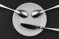 Figure of a sign of two spoons and a knife