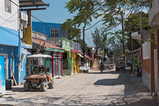 Sandy road with tourists and stalls on Holbox Island, Quintana Roo, Mexico located in north yucatan peninsula,