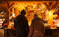 happy senior couple hugging at christmas market