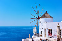 Old white windmill near sea