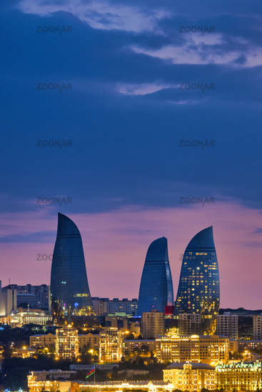 Flame towers at sunset